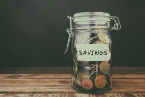 Jar of coins labeled savings