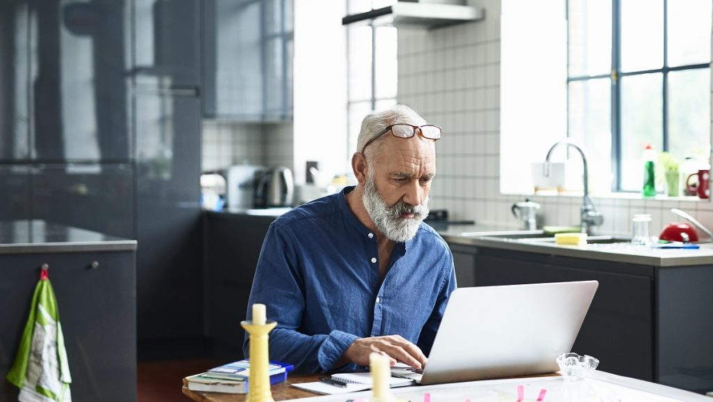 Man researching mortgage preapproval on a laptop