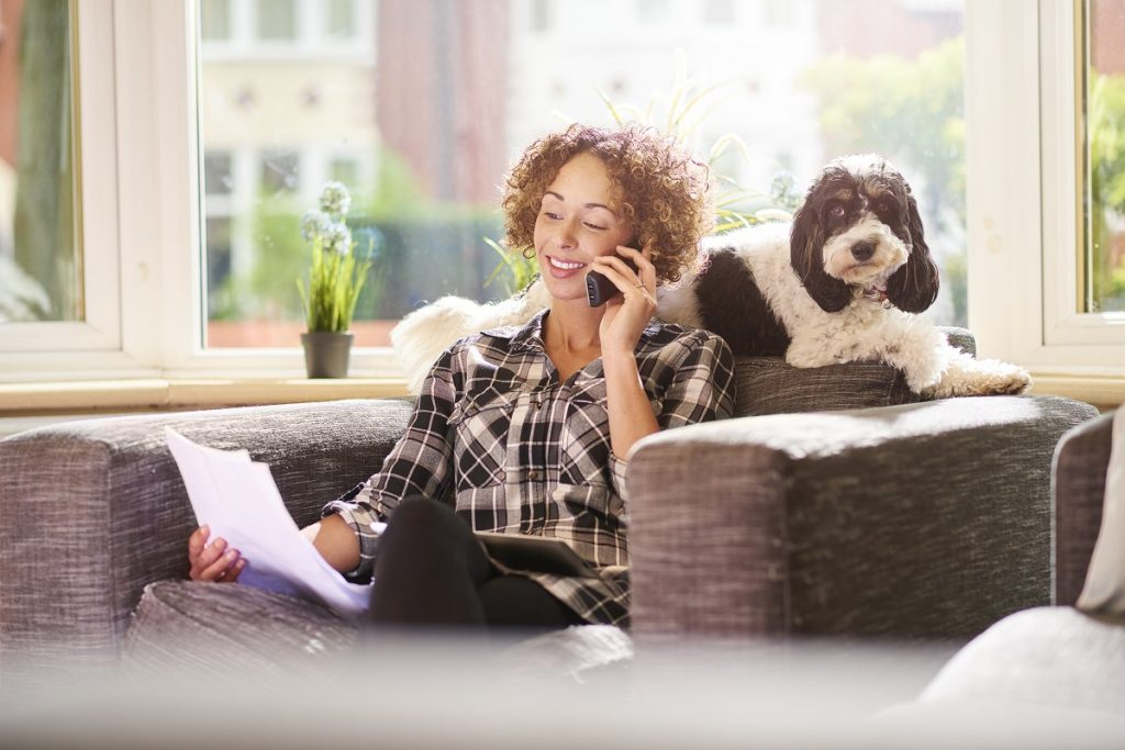 woman on the phone with her loan officer getting a mortgage