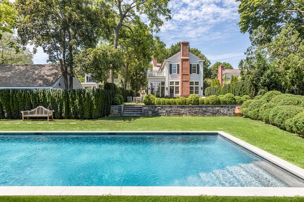 image of swimming pool and old house in sag harbor