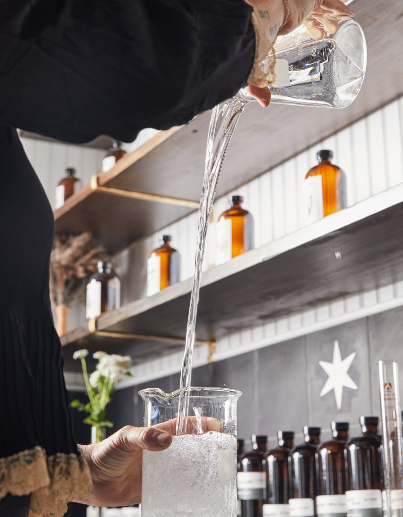 image of pouring drinks at matchbook distilling