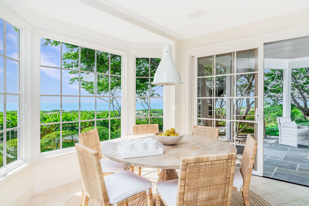 Dining area overlooking water at 32 Windmill Lane