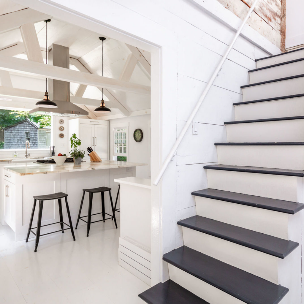A photo of the kitchen and stairs in 25 Three Mile Harbor Rd, East Hampton