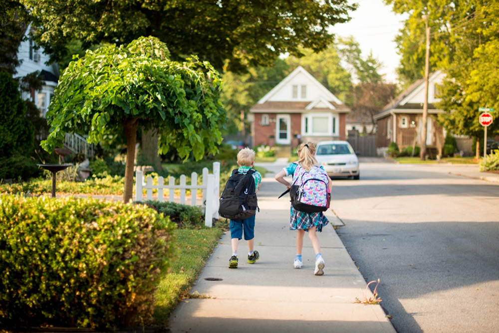two children walking to school