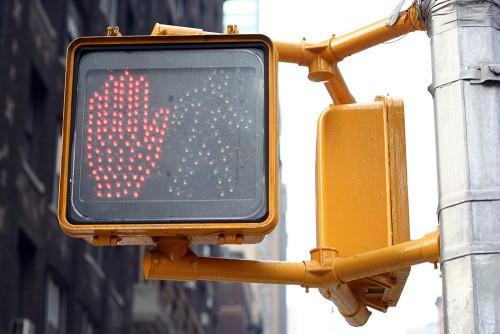 walk sign on a city street