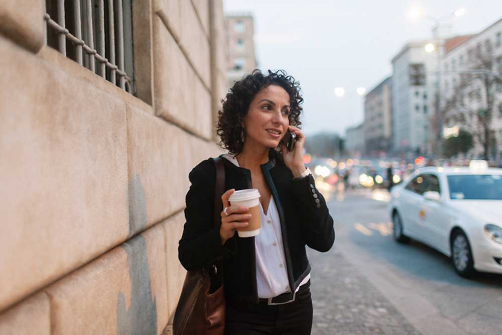 real estate agent on street talking on phone
