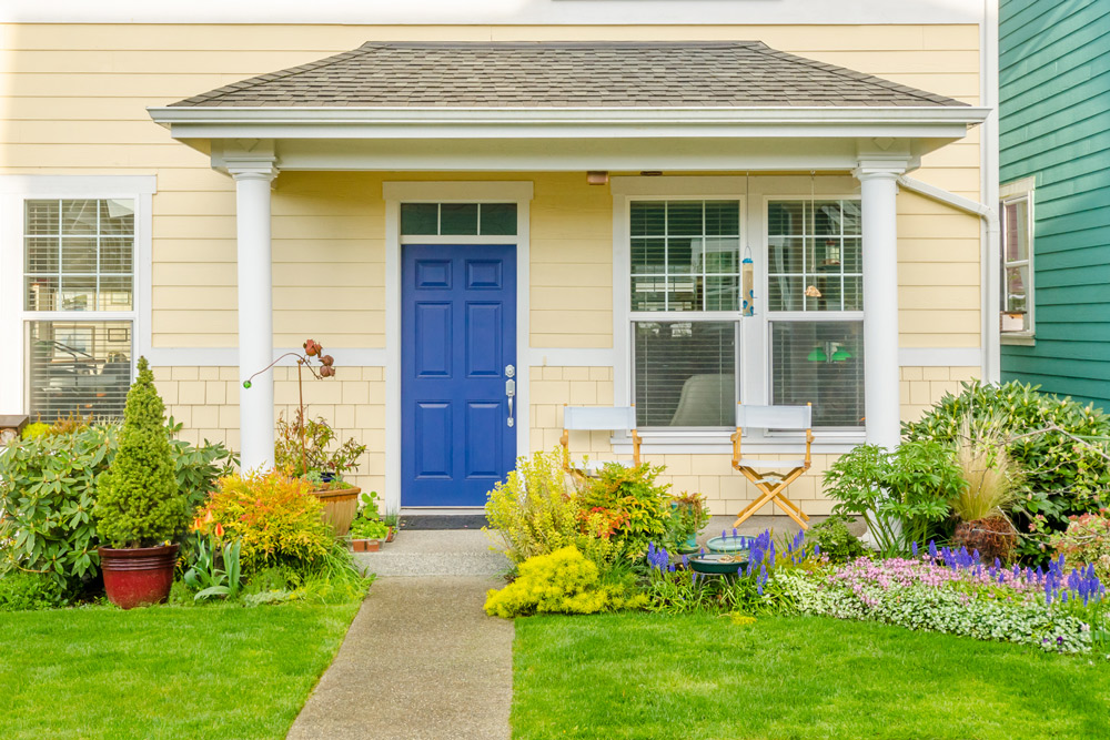 home with bright blue front door