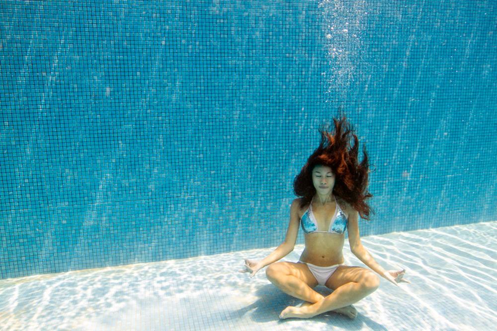 girl meditating under water