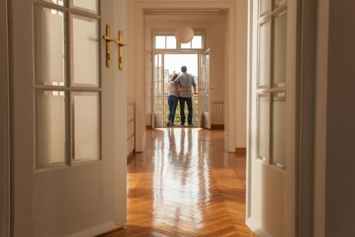 couple standing in door of new home