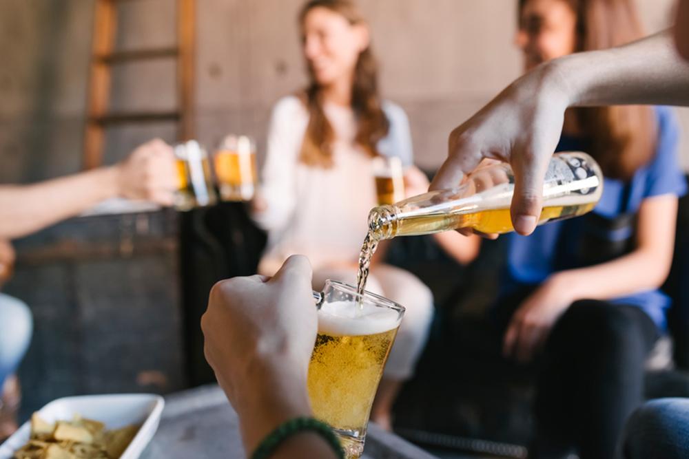 friends drinking home brew