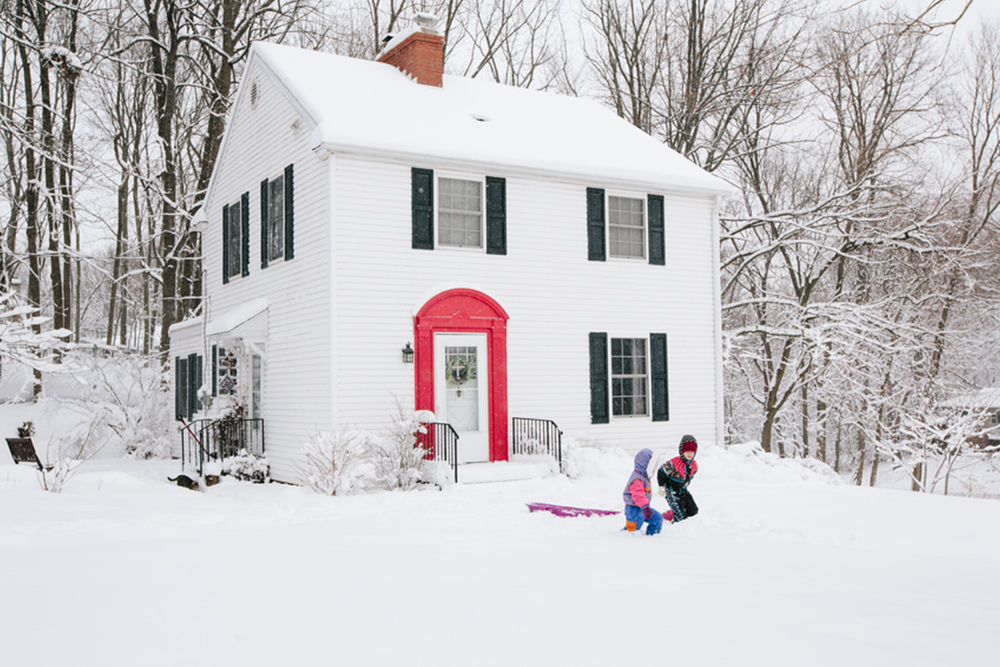 Christmas decorations on a snow covered house