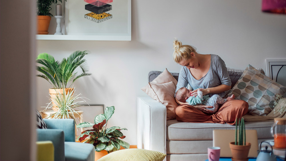 young woman with child looking at credit score rating