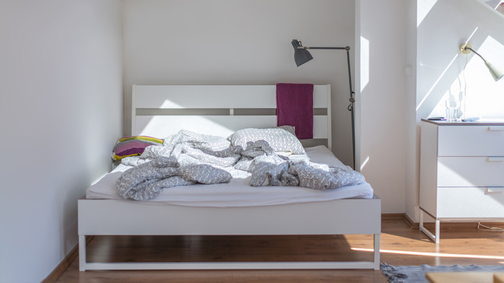 bedroom with white wall renters guide