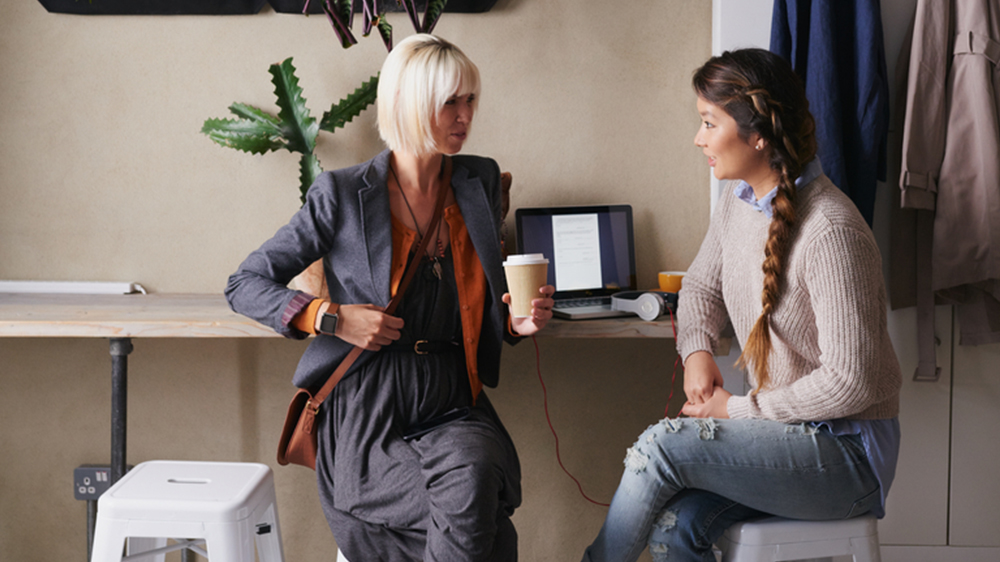 women getting coffee discussing assumable mortgage