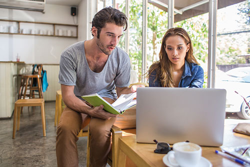 couple looking at real estate listings