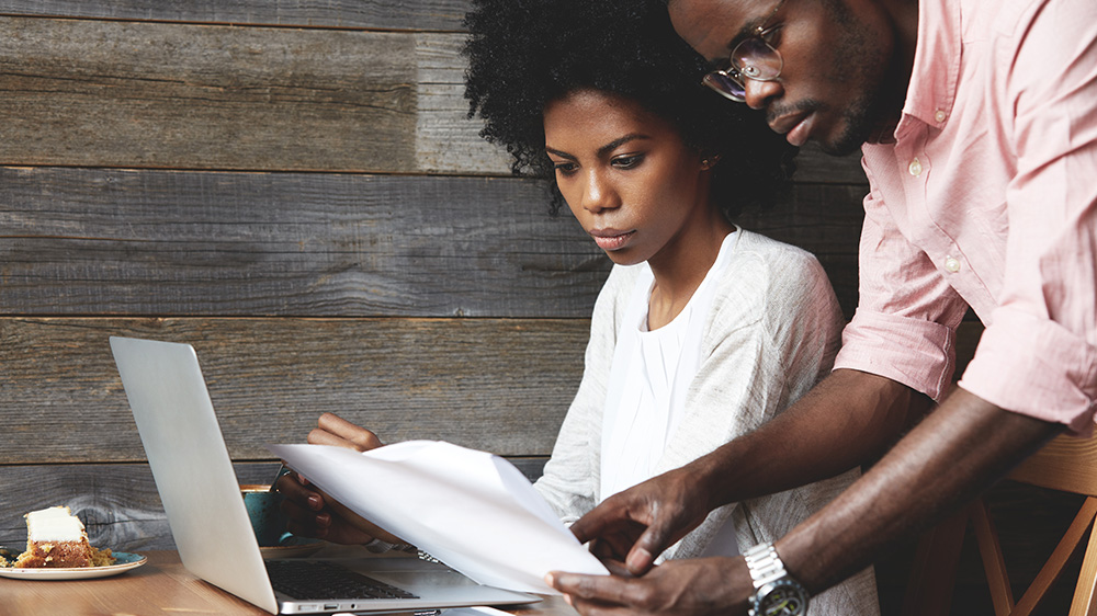 couple studying mortgage rates