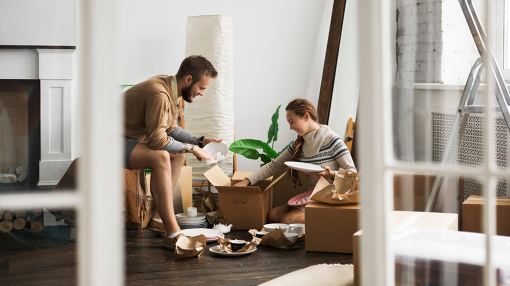 couple buying house selling apartment