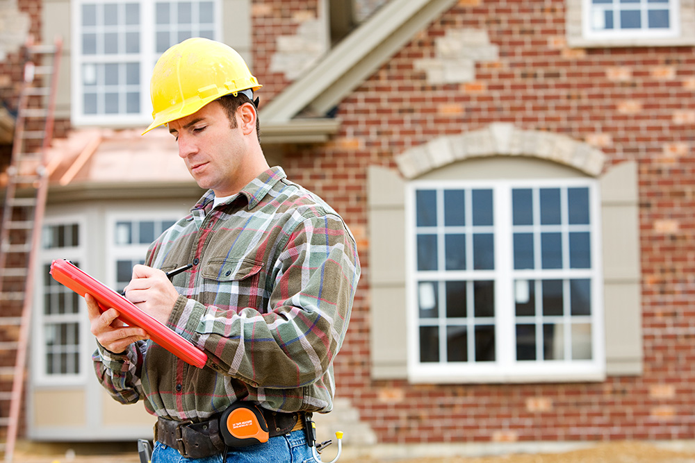 A home inspector reviewing home for a inspection contingency