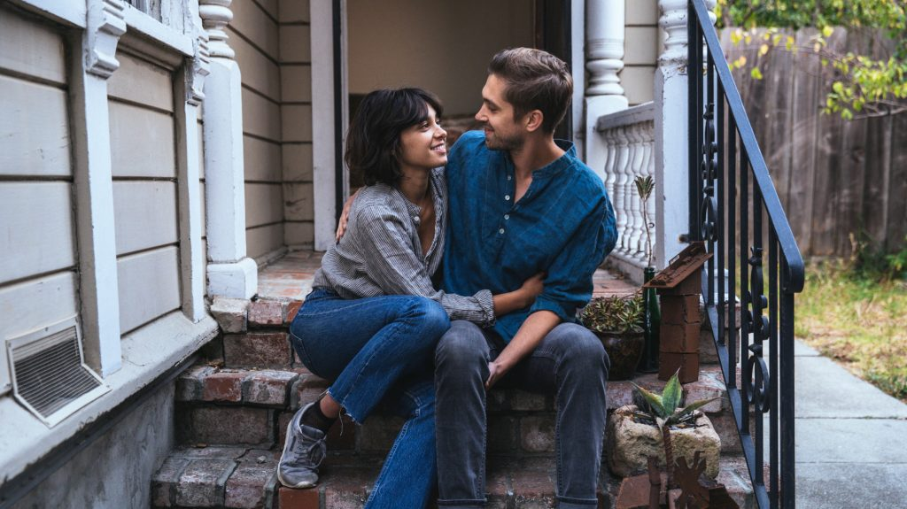 Couple on a porch in one of the hottest neighborhoods of 2019
