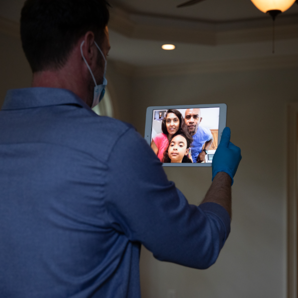 man videochatting with family