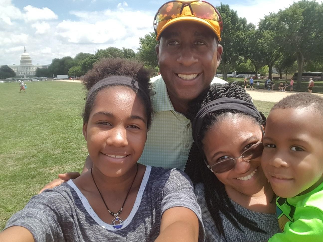 selfie-style photo of man, woman, son, daughter