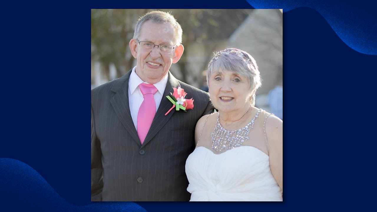 older man and woman in formal attire