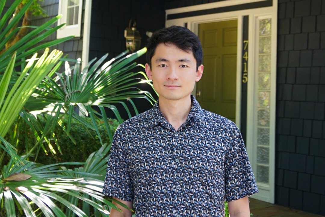 Zillow Applied Scientist Yuguang Li standing in front of a home